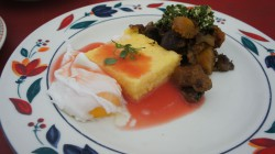 Poached eggs, polenta cakes, roasted squash with toyon sauce.